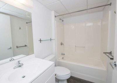 The Hub on Chestnut apartment bathroom showing vanity, toilet, and shower