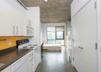 The Hub on Chestnut galley style kitchen with orange accent backsplash